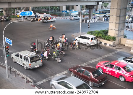 Bangkok, Thailand - January 30, 2015 :  Various vehicles break law by stop car beyond the white line on the ground during red light. - stock photo