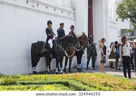 BANGKOK, THAILAND - JANUARY 24, 2015: Wat Phra Kaew in Bangkok, Thailand. Unidentified Royal Horse Guards are on duty at Thai Grand palace