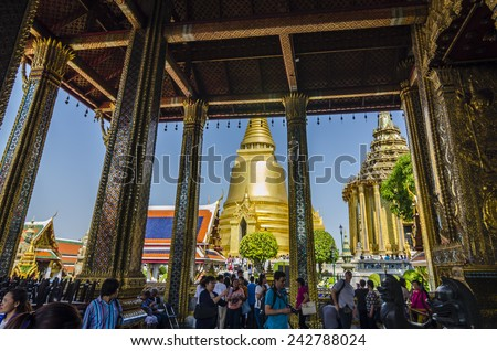 BANGKOK,THAILAND - 1 January 2014 :Wat Phra Kaew is regarded as the most sacred Buddhist temple in Thailand. It is a potent religio-political symbol and the palladium of Thai society. - stock photo