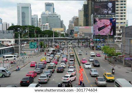 BANGKOK, THAILAND - JUL 25, 2015: Traffic nears gridlock on a busy road in the city centre in Bangkok, Thailand. Annually an estimated 150,000 new cars join the heavily congested roads of Bangkok. - stock photo