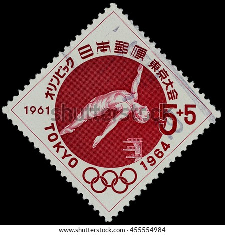 """BANGKOK, THAILAND - JULY 18, 2016: A postage stamp printed in Japan shows diving sport, series """"Tokyo Olympic Games"""", circa 1961. - stock photo"""