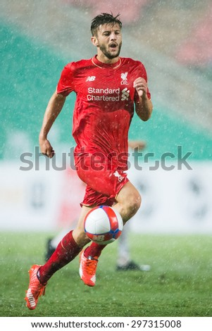 BANGKOK THAILAND JULY 14:Adam Lallana of Liverpool run with the ball during the international friendly match between Thai All Stars and Liverpool FC at Rajamangala Stadium on July14,2015 in,Thailand. - stock photo