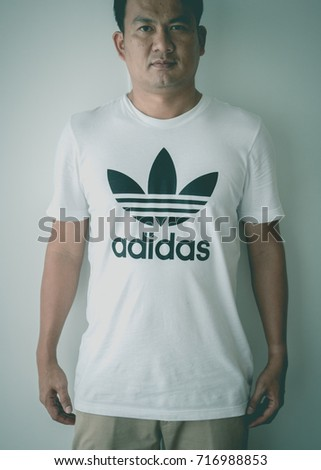 BANGKOK, THAILAND - JULY 9, 2017: Adidas logo on man T-shirt. Adidas is German designer and manufacturer of sports clothing and accessories; largest in Europe and 2nd biggest in the world.