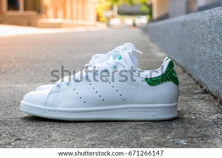 BANGKOK, THAILAND - JULY 2, 2017: Adidas stan smith classic shoes on ground stone outdoor popular fashion thailand.