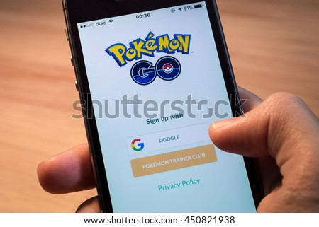 Bangkok, Thailand - July 11, 2016 : Apple iPhone5s held in one hand showing its screen with Pokemon Go application. - stock photo
