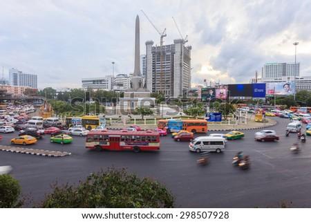 Bangkok, Thailand - July 18, 2015: Bangkok traffic at Victory monument. Bangkok is famous for its heavy traffic congestion. - stock photo