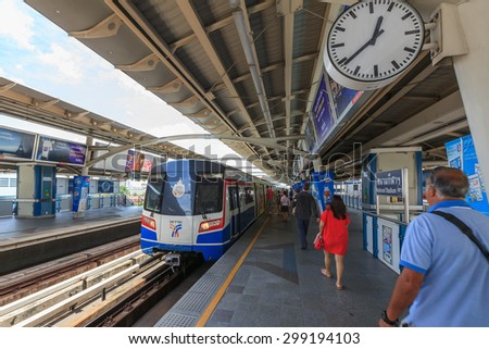 Bangkok, Thailand - July 23, 2015: Commuters  walk in BTS elevated rails, It's the first electric train system in Thailand.