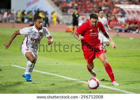 BANGKOK,THAILAND-JULY 14 : Danny Ings #28 of Liverpool in action during LFC Tour 2015 between Thai Premier League All Stars and Liverpool at Rajamangala Stadium on July 14,2015 in Bangkok,Thailand. - stock photo
