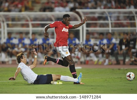 BANGKOK,THAILAND-JULY13: Danny Welbeck(L) of Manchester United in action during the friendly match between Singha All Star and Manchester United at Rajamangala Stadium on July 13, 2013 in Thailand.  - stock photo