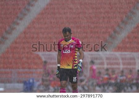 BANGKOK,THAILAND:JULY2015:(GK) Intharat Apinyakul of Chiang Rai In the rain between OsotspM150vsChiang Rai United at Rajamangala National Stadium;inThai Premier League on19July2015,Bangkok Thailand.  - stock photo