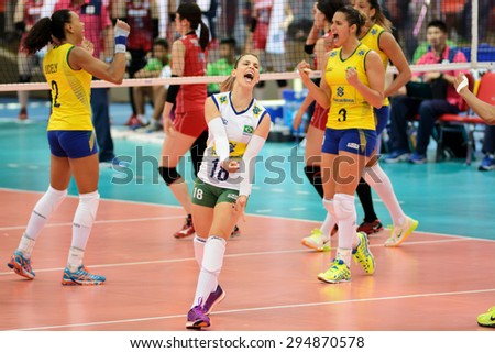Bangkok, Thailand - July 3-5 ,2015 : Group 1 women volleyball players in action in The 23rd edition of the FIVB Volleyball World Grand Prix at Hua Mak Sport Complex.