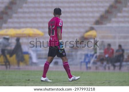 BANGKOK,THAILAND:JULY2015:Intarat Apinyakul of Chiang Rai In the rain football Thai Premier League between Osotspa M150 and Chiang Rai United at Rajamangala National Stadium on July19,2015;Thailand.  - stock photo