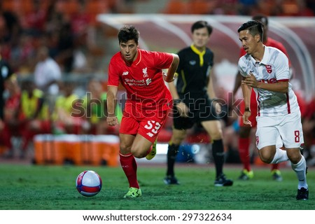 BANGKOK THAILAND JULY 14:Joao Teixeira (RED) of Liverpool run with the ball during the international friendly match Thai All Stars and Liverpool FC at Rajamangala Stadium on July14,2015 in,Thailand. - stock photo