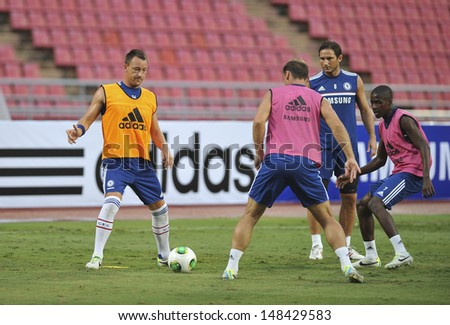 BANGKOK,THAILAND- JULY 16: John Terry(L1) of Chelsea FC in action during a Chelsea FC training session at Rajamangala Stadium on July 16, 2013 in Bangkok, Thailand.