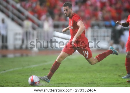 BANGKOK THAILAND JULY14:Jordan Henderson(RED)of Liverpool controls the ball  during the international friendly match Thai All Stars and Liverpool FC at Rajamangala Stadium on July 14,2015 in,Thailand - stock photo