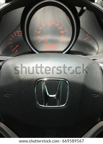 Bangkok, Thailand - July 1, 2017: Logo Honda on Black Steering Wheel. Honda is a Japanese multinational automotive manufacturing company. Close up.