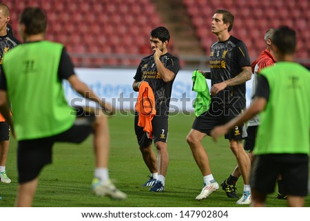 BANGKOK,THAILAND- JULY 27: Luis Suarez (c) of Liverpool FC in action during a Liverpool FC training session at Rajamangala Stadium on July 27, 2013 in Bangkok, Thailand.