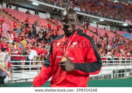 BANGKOK THAILAND JULY14:Mamadou Sakho (L)of Liverpool in action during the international friendly match between Thai All Stars and Liverpool FC at Rajamangala Stadium on July14,2015 in,Thailand. - stock photo