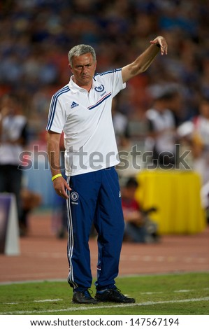 BANGKOK,THAILAND-JULY17:Manager Jose Mourinho of Chelsea in action during the international friendly match Chelsea FC and Singha Thailand All-Star at the Rajamangala Stadium on July17,2013 inThailand.