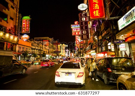 Bangkok, Thailand - 9 July, 2016: Many cars and people on Yarowat Road in the Chinatown district of the city at nighttime