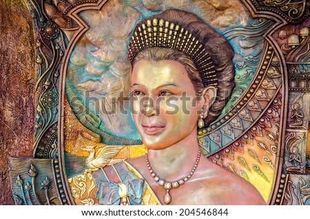 BANGKOK ,THAILAND - 9 JULY 2014 : masterpiece of traditional Thai  style sculpture on the wall of church of Wat Rama 9 Kanchana Pisek ,Portrait of Thai Queen Sirikit ,   Bangkok Thailand - stock photo