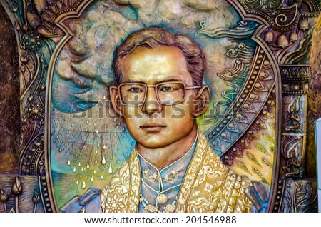 BANGKOK ,THAILAND - 9 JULY 2014 : masterpiece of traditional Thai  style sculpture on the wall of church of Wat Rama 9 Kanchana Pisek ,Portrait of Thai King Bhummibol Adulyadej   Bangkok Thailand - stock photo