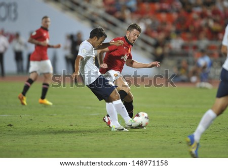 BANGKOK,THAILAND-JULY13: Michael Carrick(R1)of Manchester United in action during the friendly match between Singha All Star and Manchester United at Rajamangala Stadium on July 13, 2013 in Thailand.