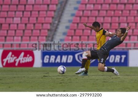 BANGKOK,THAILAND:JULY 2015:Murakami(blue)and Kritsada(yellow)poses during football Thai Premier League between OsotspaM150andChiang Rai United at Rajamangala National Stadium on July19,2015;Thailand.  - stock photo