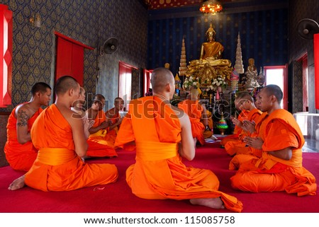 BANGKOK,THAILAND JULY 14 :  Newly ordained Buddhist monk pray with priest procession .Newly ordained Buddhist monks ahve a ritual in the temple procession in Bangkok Thailand on July 14, 2012 - stock photo