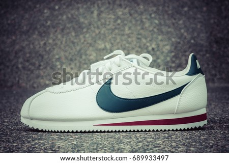 BANGKOK, THAILAND - JULY 2, 2017:Nike classic cortez white/midnight navy/gym-red  ,Nike, Inc. is an American multinational corporation that designs, develops, manufactures and sells, process color.