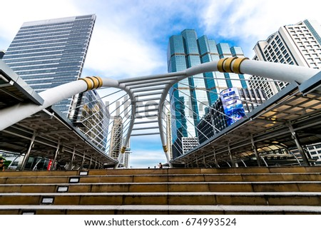Bangkok, Thailand -July 10, 2017: People walk in Chong Nonsi sky walk at bkk sky train station on Silom Line. Chong Nonsi Station is a BTS sky-train station, on the Silom Line in Bang Rak District.