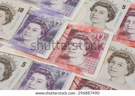 BANGKOK, THAILAND - JULY 13, 2015: portrait of Her Majesty Queen Elizabeth II on England 50 Pound Sterling note - stock photo