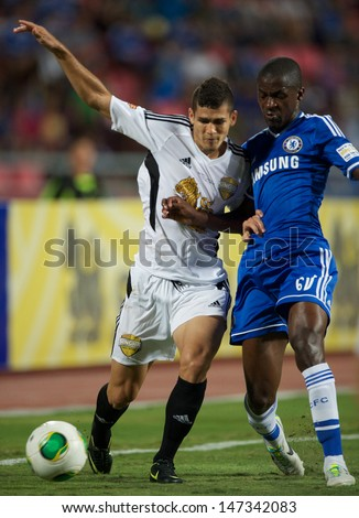BANGKOK,THAILAND-JULY17:Ramires (R) of Chelsea in action during the international friendly match Chelsea FC and Singha Thailand All-Star at the Rajamangala Stadium on July17,2013 inThailand.