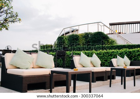 BANGKOK, THAILAND, JULY 25, 2015: Restaurant couch bar with view of Bangkok Cityscape at the Three Sixty  Lounge of Millennium Hilton Bangkok Hotel in Bangkok, Thailand. - stock photo