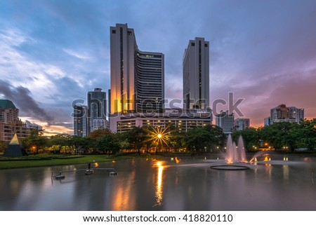 BANGKOK THAILAND- JULY 24: Soft focus sunset and raincloud, view of downtown on July 24, 2014 at Benjasiri Park in Bangkok, Thailand