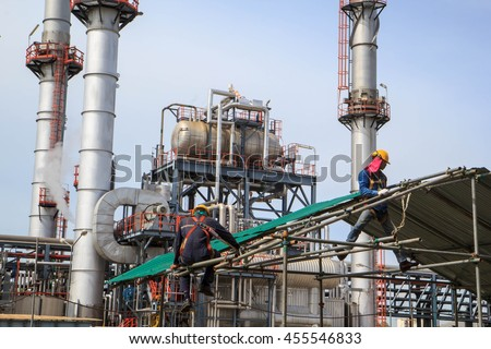 Bangkok,Thailand - July 19th, 2016: Construction workers installing scaffolding Refinery plant Industry oil and gas