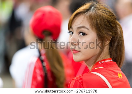 BANGKOK,THAILAND-JULY 14 : Thai fans cheer in action during LFC Tour 2015 between Thai Premier League All Stars and Liverpool at Rajamangala Stadium on July 14,2015 in Bangkok,Thailand. - stock photo