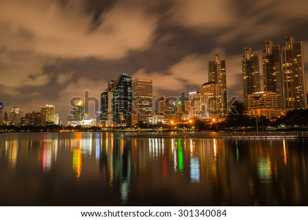 BANGKOK, THAILAND-JULY 29 : The business skyscraper skyline is in Bangkok city downtown with reflection on wide lake in Bangkok, Thailand July 29, 2015