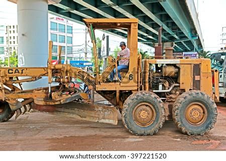 BANGKOK-THAILAND-JULY 7 : The loader for construction the road on July 7, 2015 Bangkok, Thailand  - stock photo
