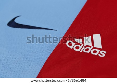 BANGKOK, THAILAND - JULY 10, 2016: The  Logo of Nike and Adidas Brand  on Football Jerseys on July 10,2016 in Bangkok Thailand.