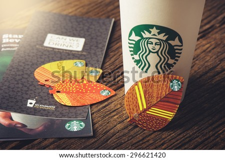 BANGKOK, THAILAND - JULY 15, 2015: The Starbucks autumn fall leaf shape key ring gift card. - stock photo