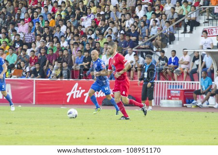 BANGKOK, THAILAND - JULY 21 : Unidentified player in Thai Premier League (TPL) BEC Tero (red) VS Chonburi Fc (Blue) at Thebhussadin Stadium on July 21 , 2012 in Bangkok,Thailand.