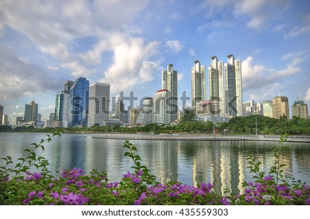 BANGKOK, THAILAND - JULY 11: View from Benchakitti Park, located under Ratchadaphisek Road, near Sukhumvit MRT Station and Queen Sirikit National Convention Centre in BANGKOK THAILAND on JULY 11, 2015