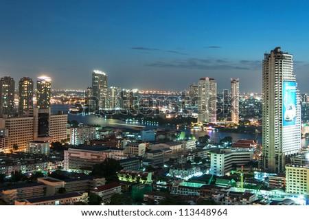 BANGKOK, THAILAND - JULY 21:View of Bangkok cityscape in the night on July 21, 2012. Bangkok received World's Best City Award 2012 - stock photo