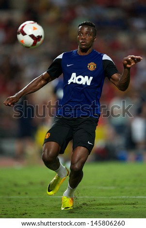 BANGKOK, THAILAND-JULY 12:Wilfried Zaha of Manchester United in action during a first team training pre-season tour of Bangkok at Rajmalanga Stadiumon July 12, 2013 in Bangkok, Thailand.