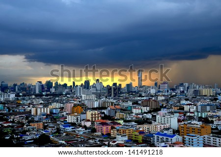BANGKOK, THAILAND - JUN 8: Hard rain in Bangkok, Thailand on June 8, 2013 . Severe flooding occurred in the 2011, many people have lost their home. - stock photo