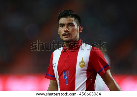 BANGKOK THAILAND JUN 3:Kroekrit Thaweekarn(Red) of Thailand in action during the King's Cup 2016 Match between Thailand and Syria at Rajamangala Stadium on June 3,2016 in Thailand.