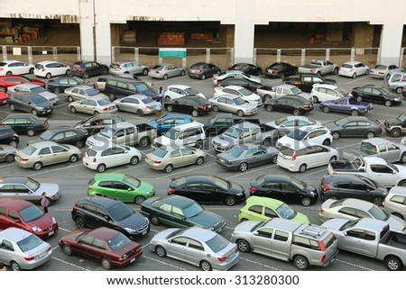 BANGKOK THAILAND - JUN 13 : Many cars in parking lot on Jun 13, 2015 at Mo Chit Skytrain station in Bangkok, Thailand