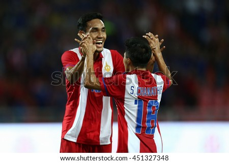 BANGKOK THAILAND JUN 3:Teerasil Dangda(Red) of Thailand celebrate during the King's Cup 2016 Match between Thailand and Syria at Rajamangala Stadium on June 3,2016 in Thailand.