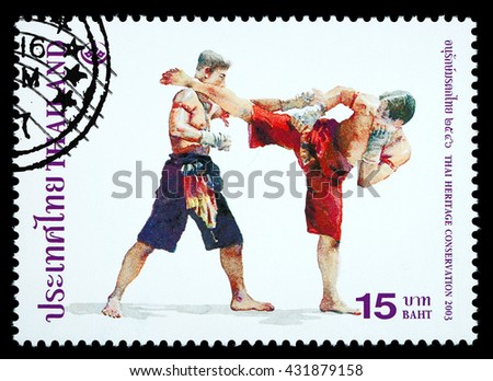 Bangkok Thailand - June 2010: A Thai postage stamp printed in Thailand depicting a traditional Muay Thai boxing, circa 2003 - stock photo